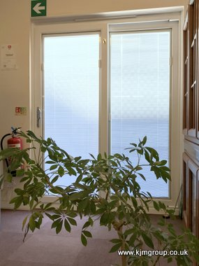 White integral blind in a sliding patio door