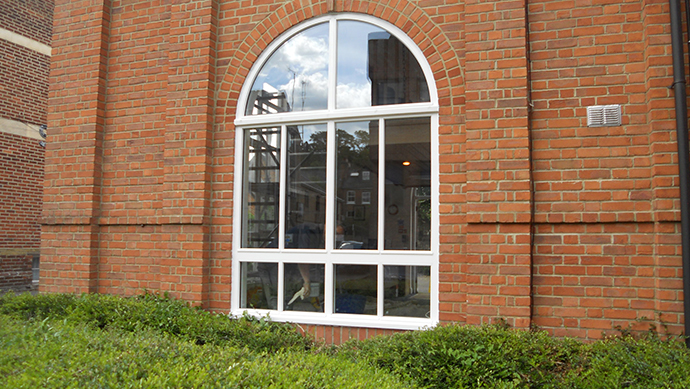 Hardwood arched window in white