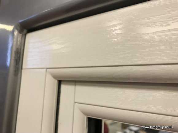 Veka mechanical jointed white wood-grain window
