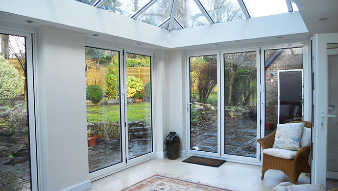 Two bi-folding doors in a conservatory