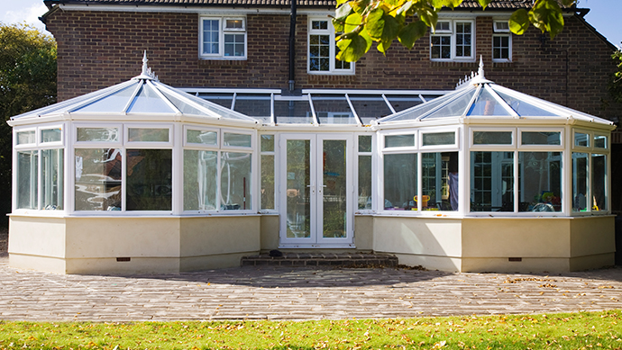 PVCu conservatory in white with fanlight openings and french doors