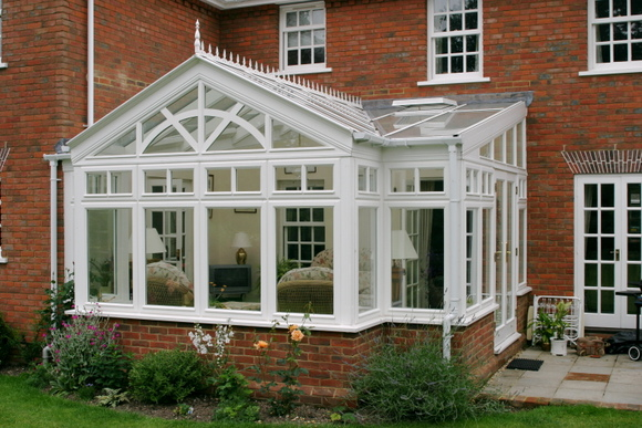 Conservatory in hardwood with sunburst effect gable