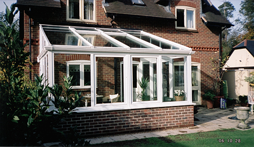Mono pitch conservatory with high roof in white