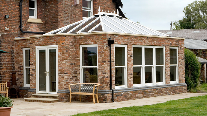 Orangery Conservatory with white sliding sash uPVC windows