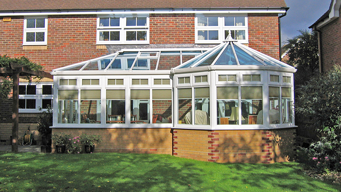 P-Shape conservatory with feature bricks