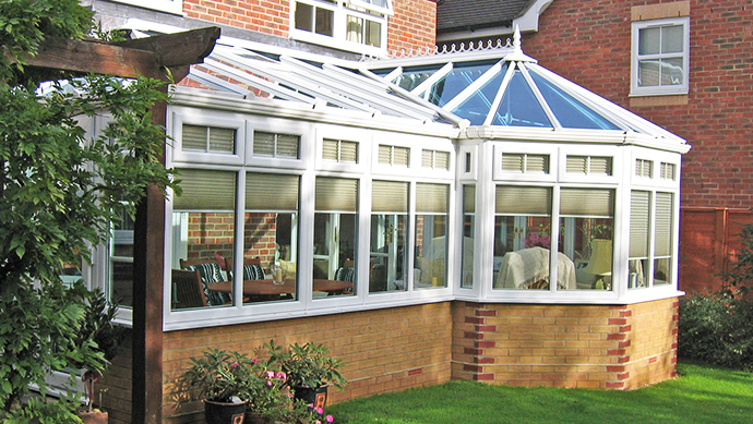 P-shape conservatory in white external view