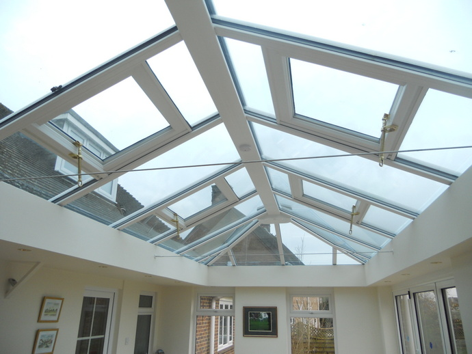 Replacement conservatory roof with Livinroom pelmet and electric roof vents