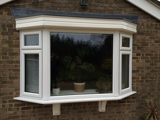 Bay window in white PVC with fanlights